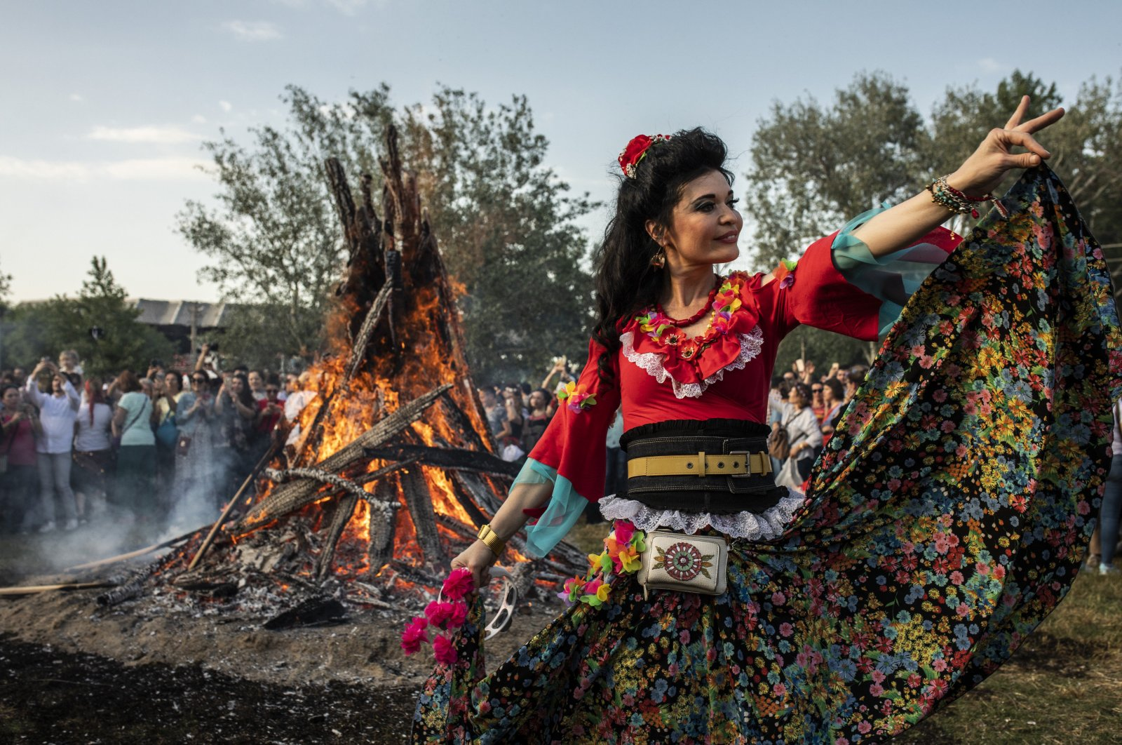 In this undated photo, a woman in traditional attire dances during the Kakava (Hıdırellez) celebrations in the border province of Edirne. (DHA Photo)