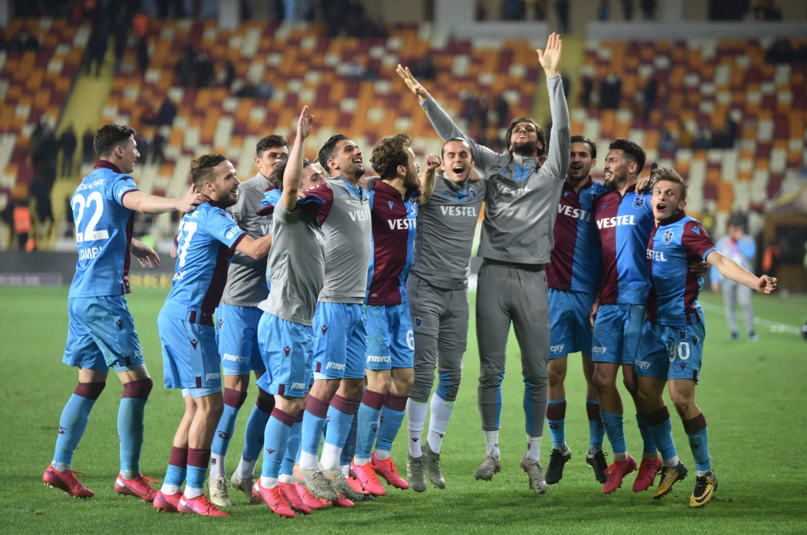 Trabzonspor players celebrate a victory over Yeni Malatyaspor in Malatya, Turkey, March 12, 2020. (İHA Photo)