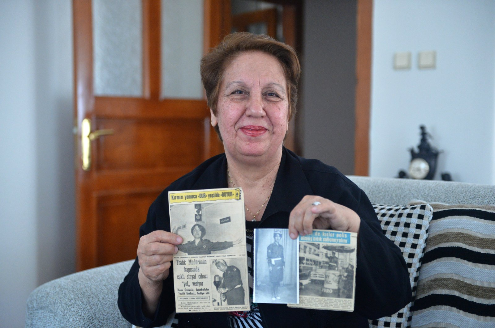 Fikriye Yavuz shows clippings with stories about her, in Mersin, Turkey, Wednesday, May 6, 2020. (AA Photo)