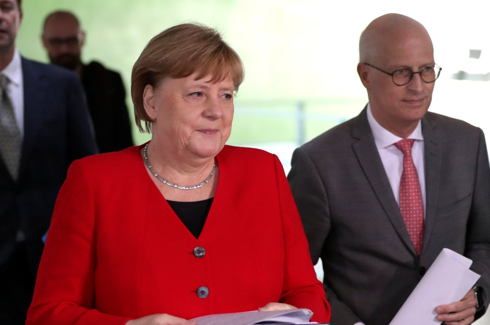 German Chancellor Angela Merkel (L) and Peter Tschentscher, First Mayor of Hamburg, arrive at a news conference after an online meeting with German state governors on the loosening of the restrictions to reduce the spread of the coronavirus disease (COVID-19), Berlin, Germany, May 6, 2020. (Reuters Photo)