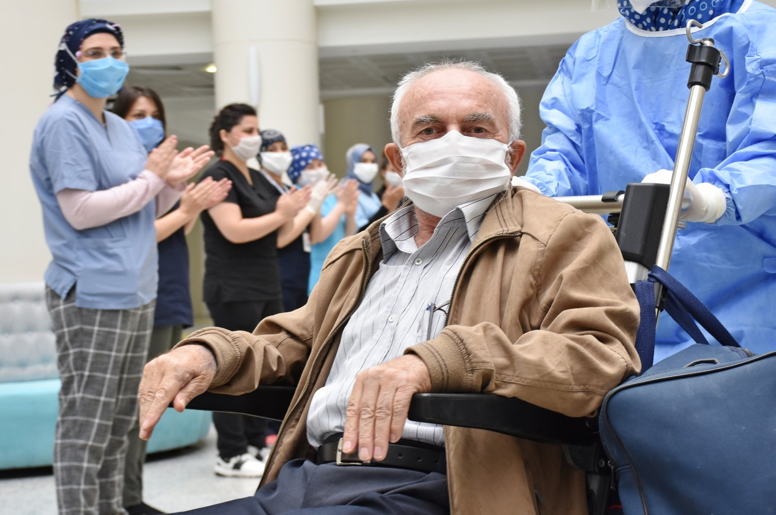 71-year-old Muammer Yıldız poses for a photo after recovery in Turkey's western Manisa (AA Photo)