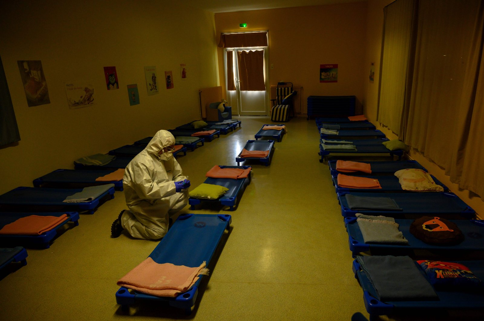 A French fireman collects sample in the sleeping room of a school of Marseille to control the possible presence of the coronavirus, on May 5, 2020, as the schools in France are to gradually reopen from May 11, when a partial lifting of restrictions due to the COVID-19 pandemic caused by the novel coronavirus comes into effect. (AFP Photo)