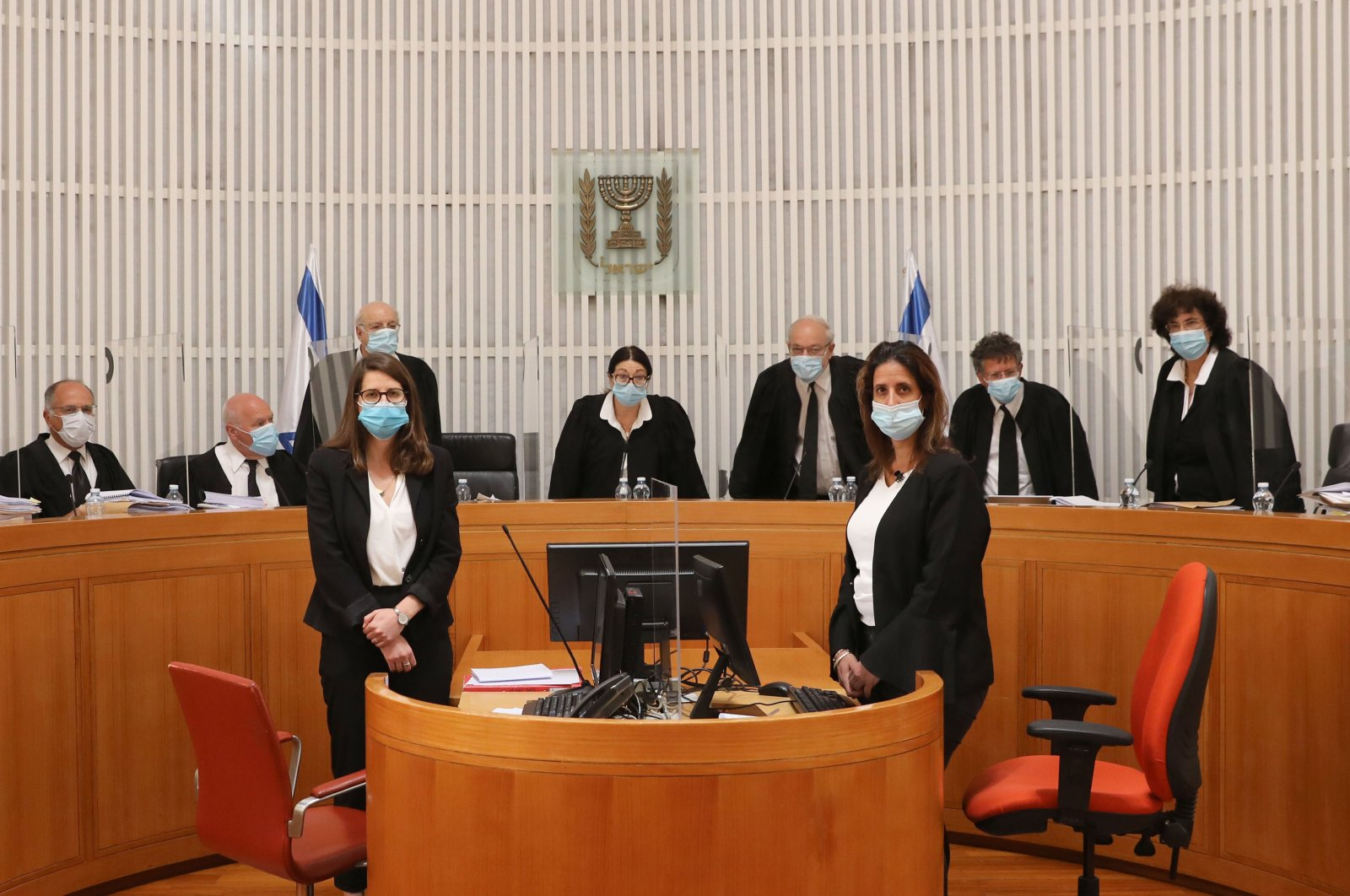 Judges and personnel of the Israeli Supreme Court wearing face masks against the coronavirus Covid-19, attend a session on May 4, 2020 at the Supreme Court in Jerusalem. (AFP Photo)