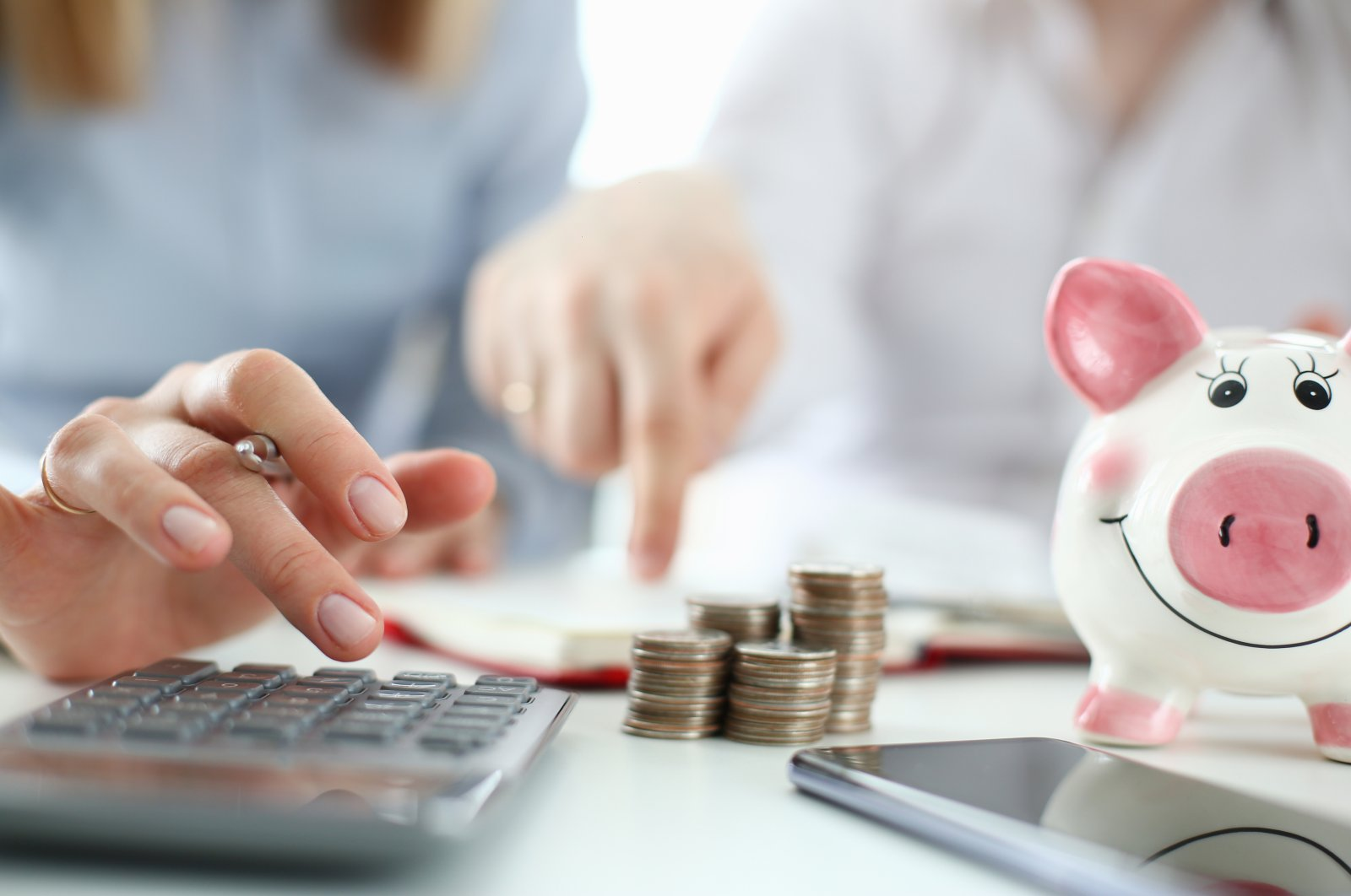 Don't let your debts get out of control and try to monitor your spending during difficult times. (iStock Photo)