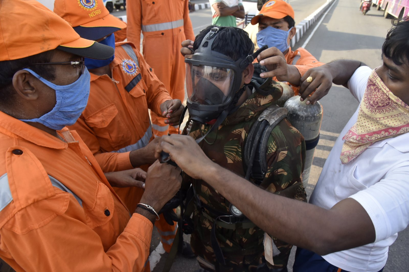A National Disaster Response Force (NDRF) soldier is fitted with gear before he proceeds to the area from where chemical gas leaked in Vishakhapatnam, India, Thursday, May 7, 2020. (AP Photo)