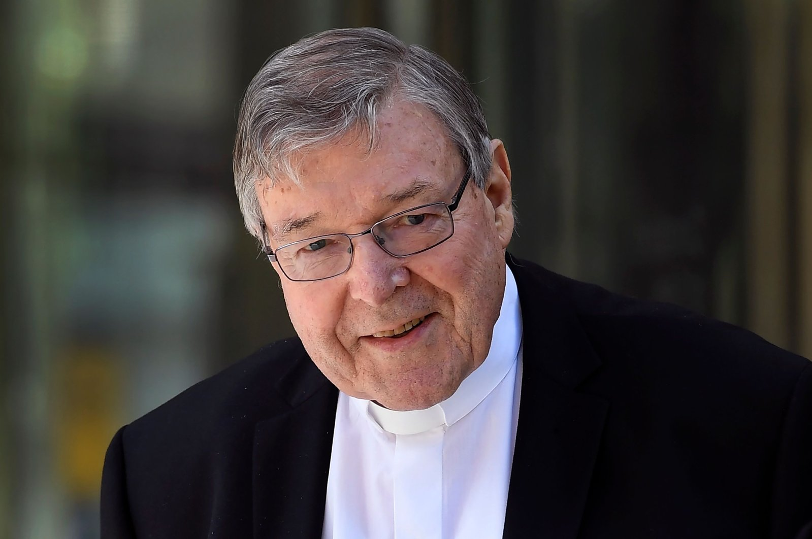 This Dec. 10, 2018, file photo shows Cardinal George Pell walking to a car in Melbourne, Australia. (AFP Photo)