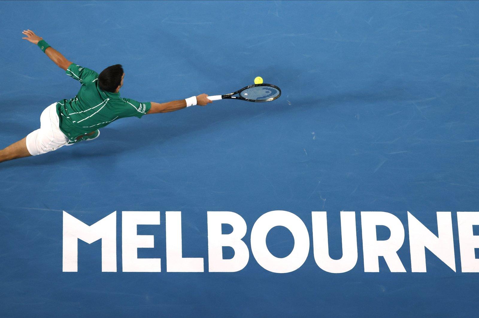 Novak Djokovic makes a forehand return to Dominic Thiem at the Australian Open in Melbourne, Australia, Feb. 2, 2020. (AP Photo)