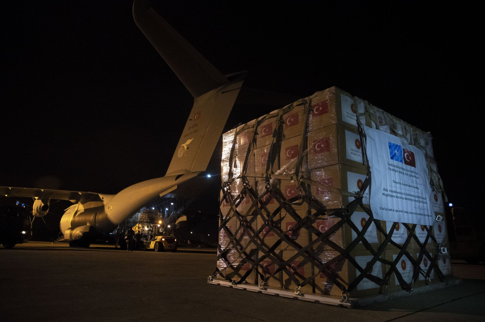A Turkish military cargo plane with medical supplies and protective equipment to combat COVID-19 in Somalia is loaded at an airport in Ankara, Turkey, May 3, 2020. (AA Photo)