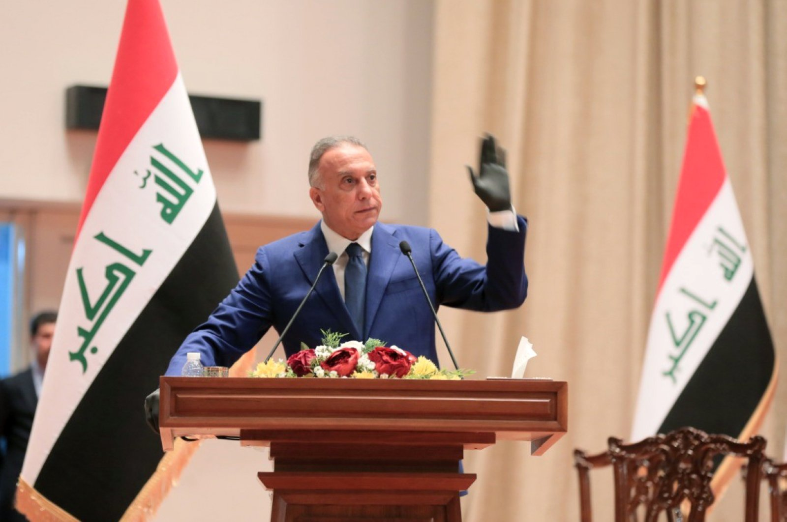 Iraqi Prime Minister Mustafa al-Kadhimi taking the oath in front of the parliament during an overnight session in Baghdad, May 7, 2020. (AFP)
