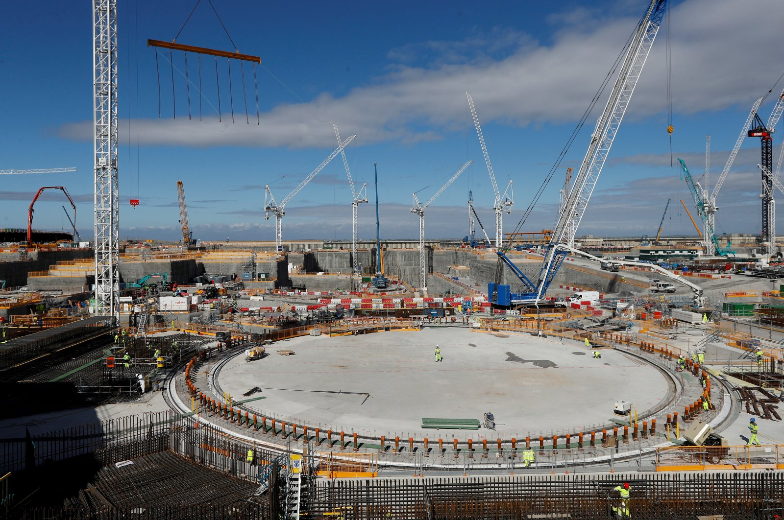Workers at the nuclear reactor area under construction, are seen at Hinkley Point C nuclear power station site, near Bridgwater, Britain, September 12, 2019. (Reuters Photo)