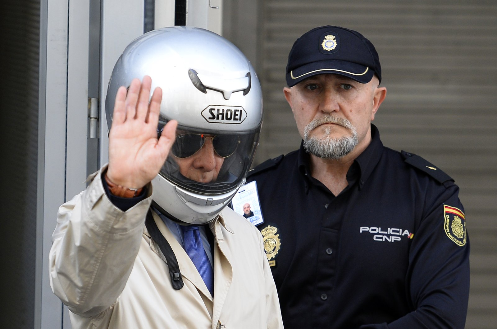 """Former Franco officer Juan Antonio Gonzalez Pacheco, alias """"Billy el Nino"""" (Billy the Kid), leaves the Spanish National Court after his extradition hearing, Madrid, April 10, 2014. (AFP Photo)"""