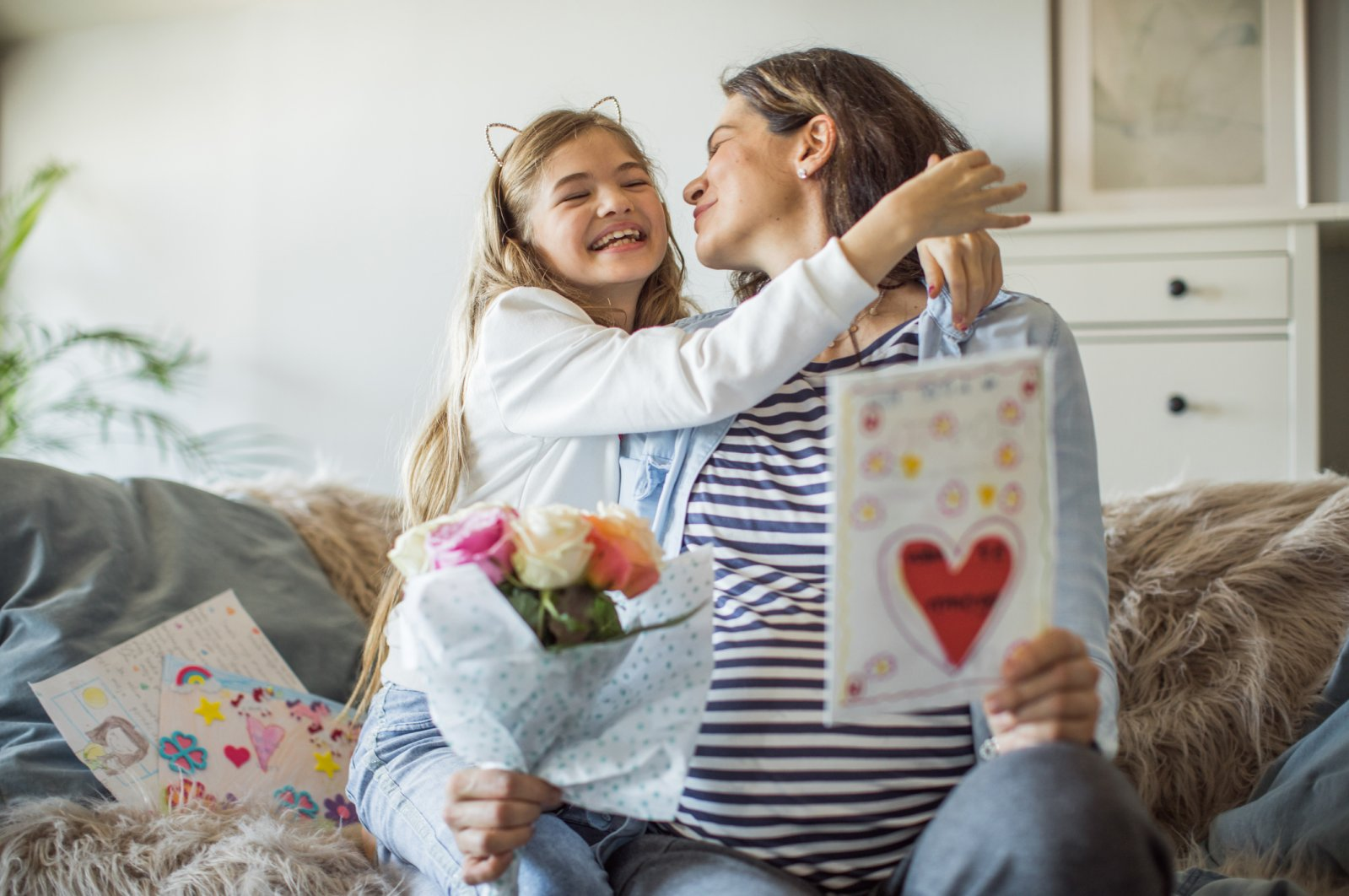 Many children like to surprise their mothers with bouquets of flowers and greeting cards on Mother's Day. (iStock Photo)