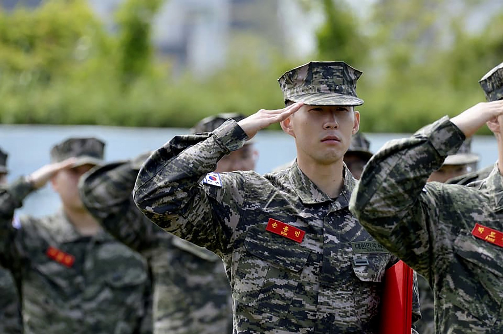 In this photo provided by South Korea Marine Corps' Facebook, Tottenham Hotspur forward Son Heung-min salutes during a basic military training completion ceremony at a Marine Corps boot camp in Seogwipo on Jeju Island, South Korea, Friday, May 8, 2020. (South Korea Marine Corps' Facebook via AP)