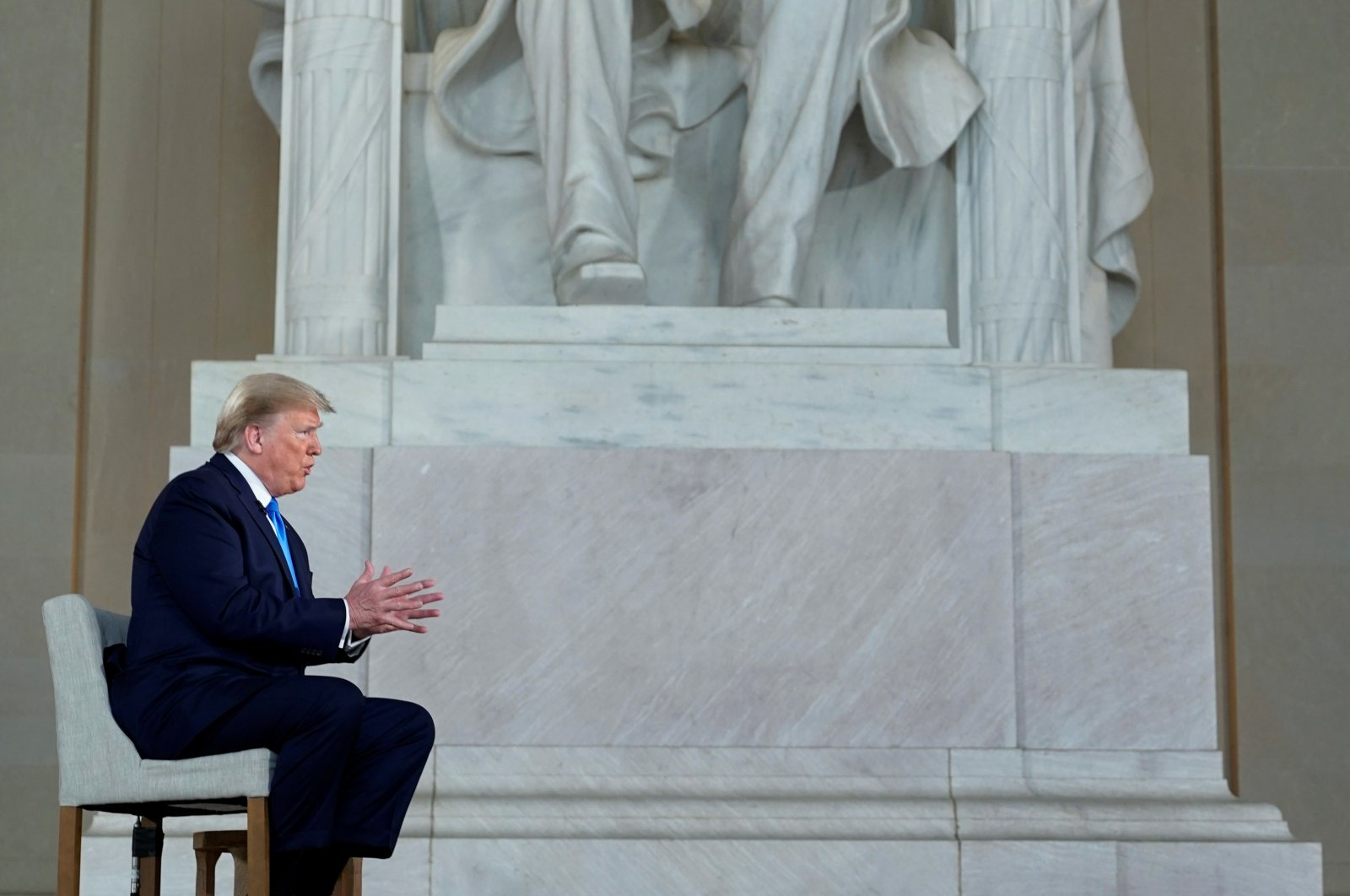 U.S. President Donald Trump participates in a live Fox News Channel virtual town hall about the response to the coronavirus pandemic, as he sits in front of the statue of former President Abraham Lincoln inside the Lincoln Memorial in Washington, D.C., U.S., May 3, 2020. (Reuters Photo)