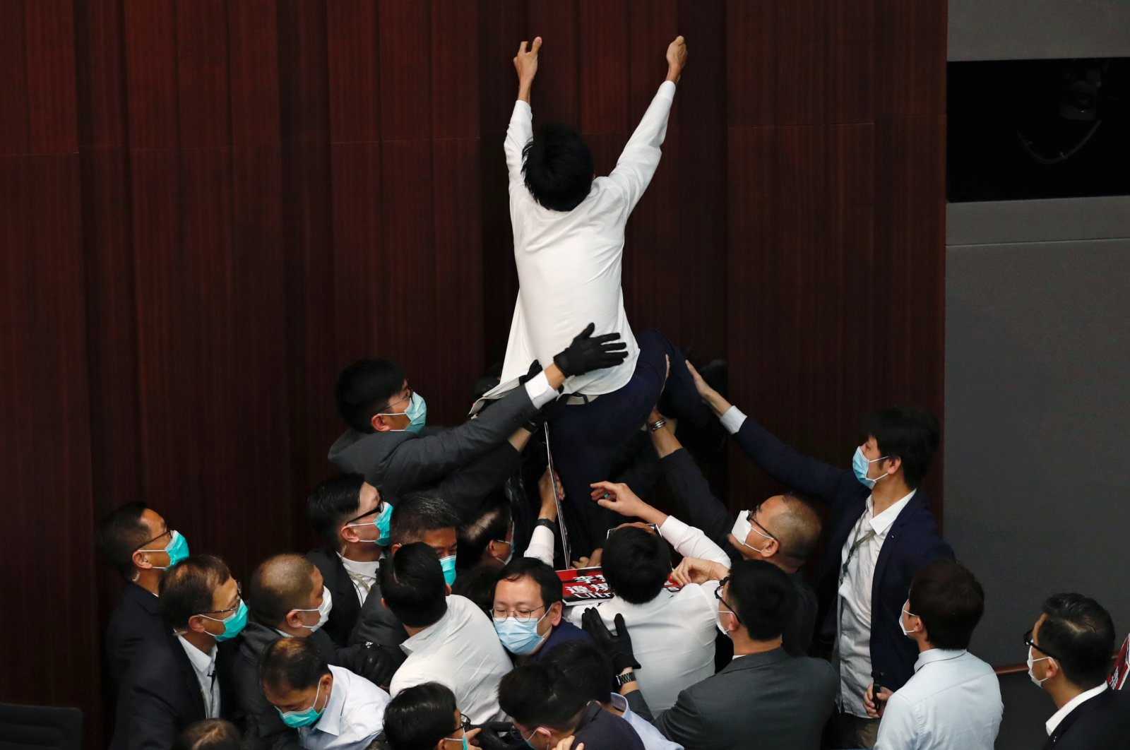 Pan-democratic legislator Eddie Chu Hoi-dick scuffles with security and pro-China legislators during Legislative Council's House Committee meeting, in Hong Kong, China, May 8, 2020. (Reuters Photo)