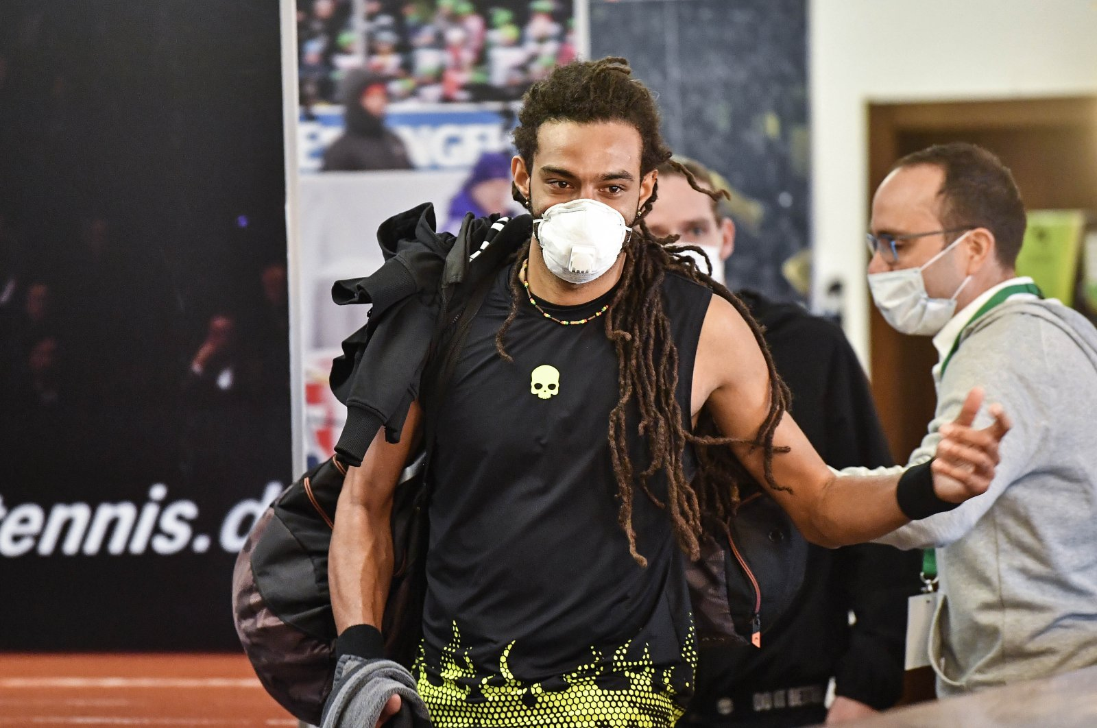 Tennis player Dustin Brown wears a face mask at a pro-tennis tournament in Hoehr-Grenzhausen, Germany, , May 1, 2020. (AP Photo)