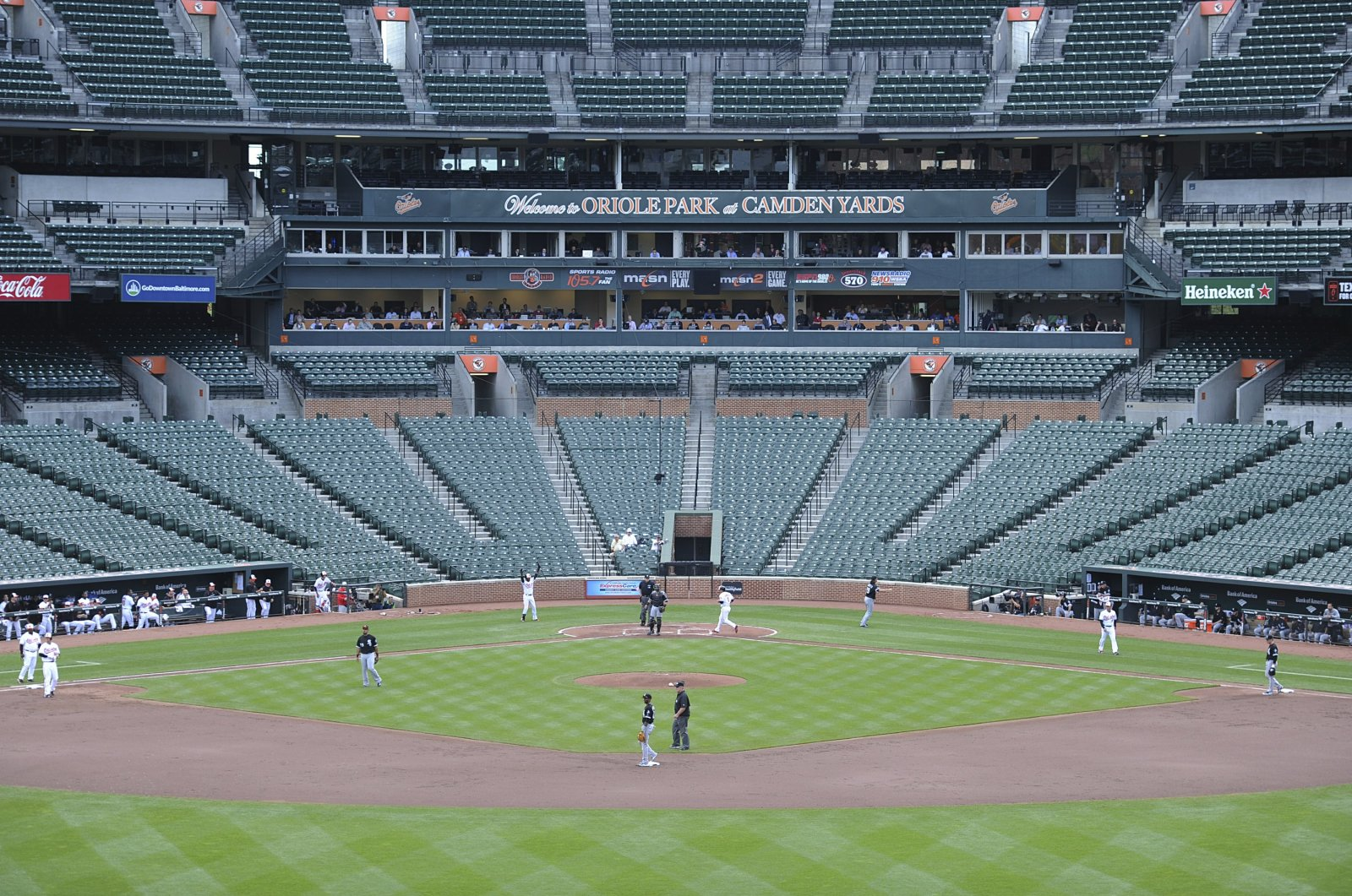 U.S. sports leaders trying to decide whether to bar fans from venues to avoid further fueling the coronavirus outbreak. (AP Photo)