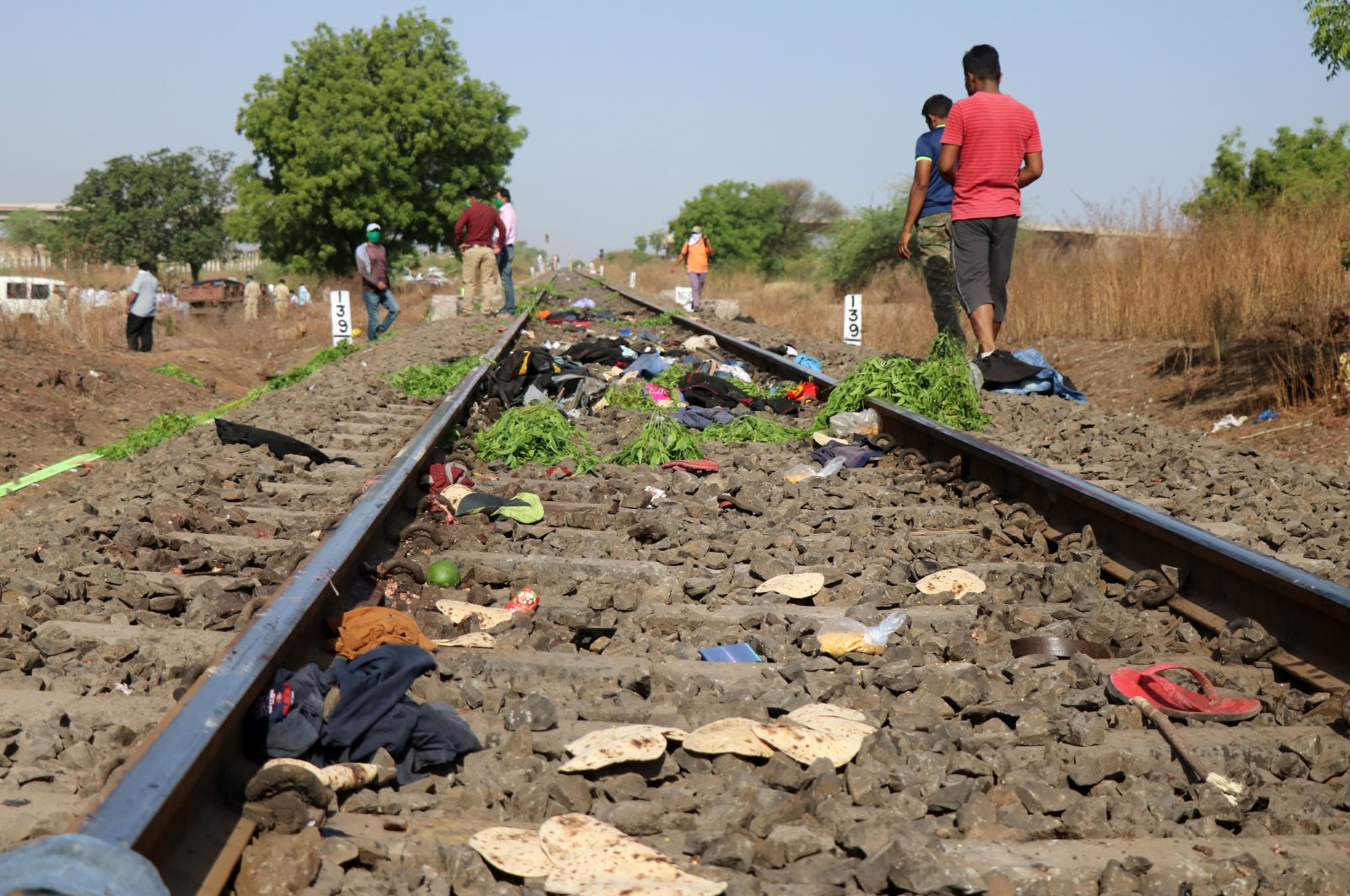 The belongings of victims lie scattered after a train ran over migrant workers sleeping on the track in the Aurangabad district of the western state of Maharashtra, India, May 8, 2020. (Reuters Photo)