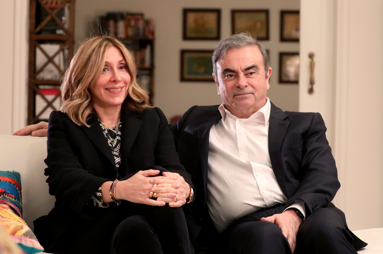 Former Nissan chairman Carlos Ghosn and his wife Carole Ghosn talk during an interview with Reuters in Beirut, Lebanon, Jan. 14, 2020. (Reuters Photo)