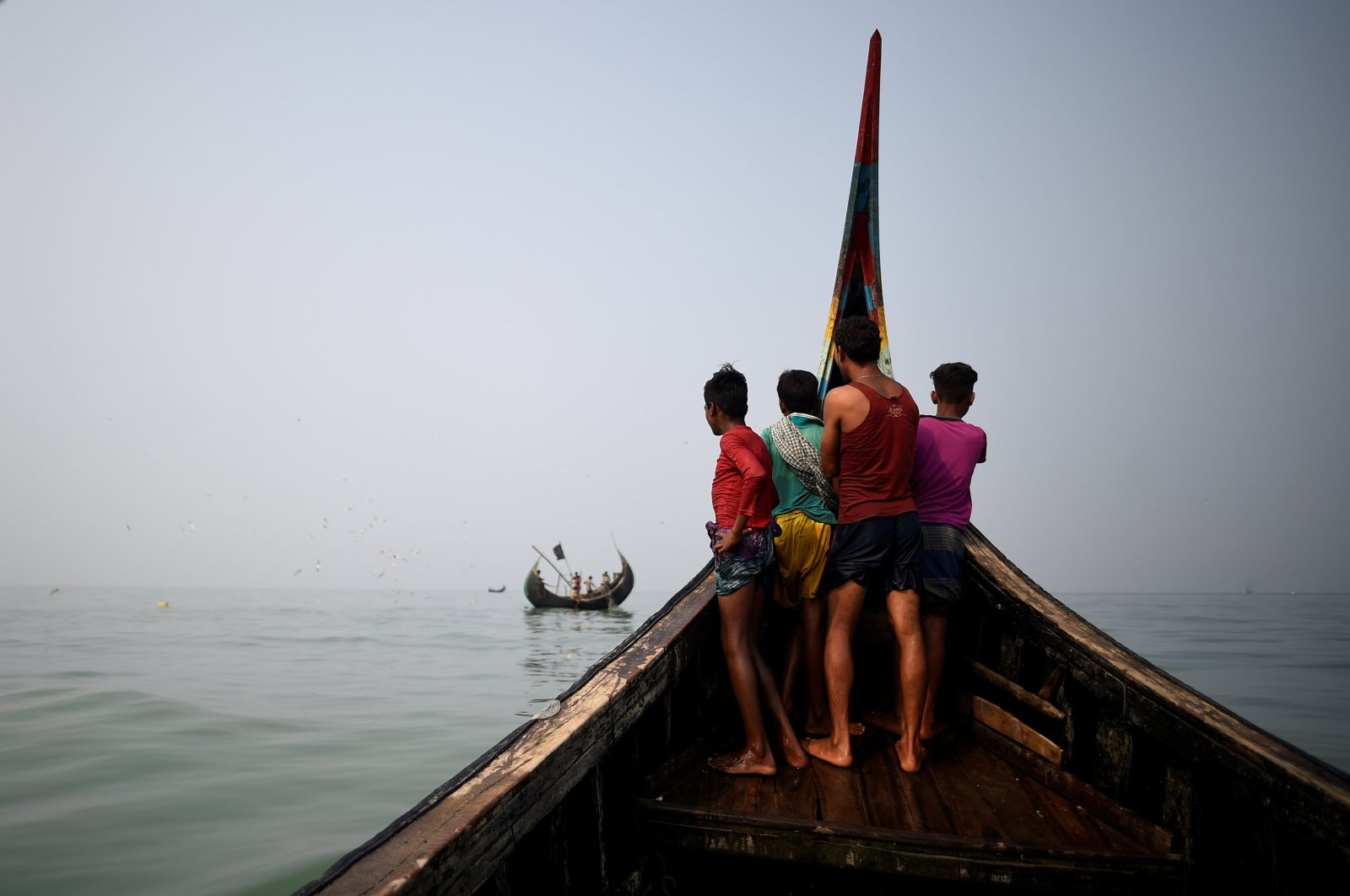 Rohingya refugees crew a fishing boat in the Bay of Bengal near Cox's Bazaar, March 24, 2018. (Reuters Photo)