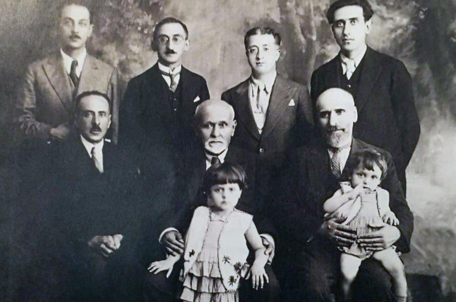Standing from left to right, Mahir İz, Ali Nihat Tarlan, Abdülbaki Gölpınarlı, Şeyh Sadettin Nüzhet Ergün and sitting from left to right, Abdülbaki Baykara, Ömer Ferid Kam and Tahir Olgun.