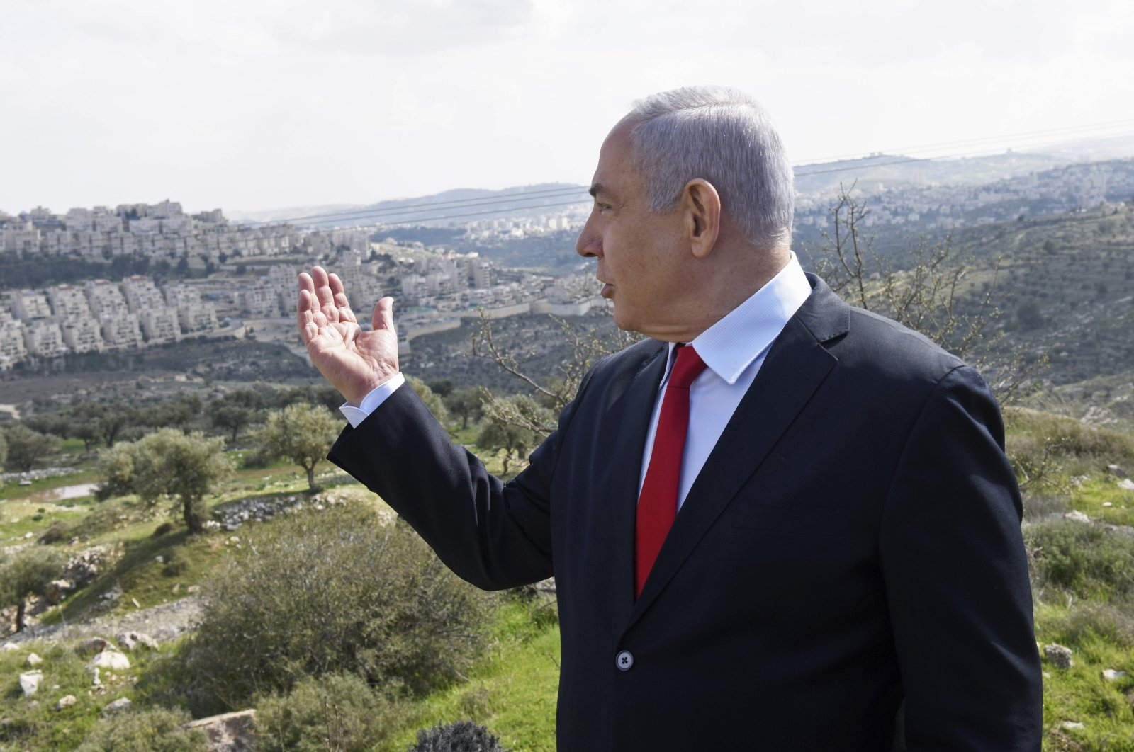 Israeli Prime Minister Benjamin Netanyahu visits the area where a new neighborhood is to be built in the east Jerusalem settlement of Har Homa, Israel, Feb. 20, 2020. (AP Photo)