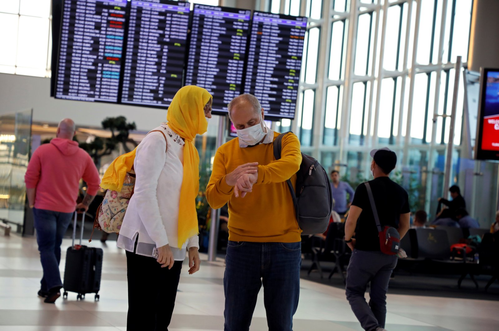 People wear protective face masks in light of the coronavirus pandemic, at Istanbul Airport, Istanbul, Turkey, March 13, 2020. (Reuters Photo)
