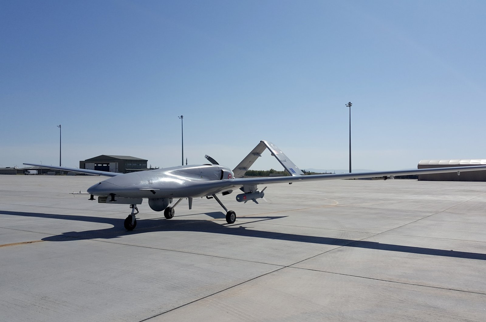A Bayraktar TB2 armed drone, which was domestically produced by Turkey's leading unmanned aerial platform developer Baykar, is parked at an airfield in 2017. (AA Photo)