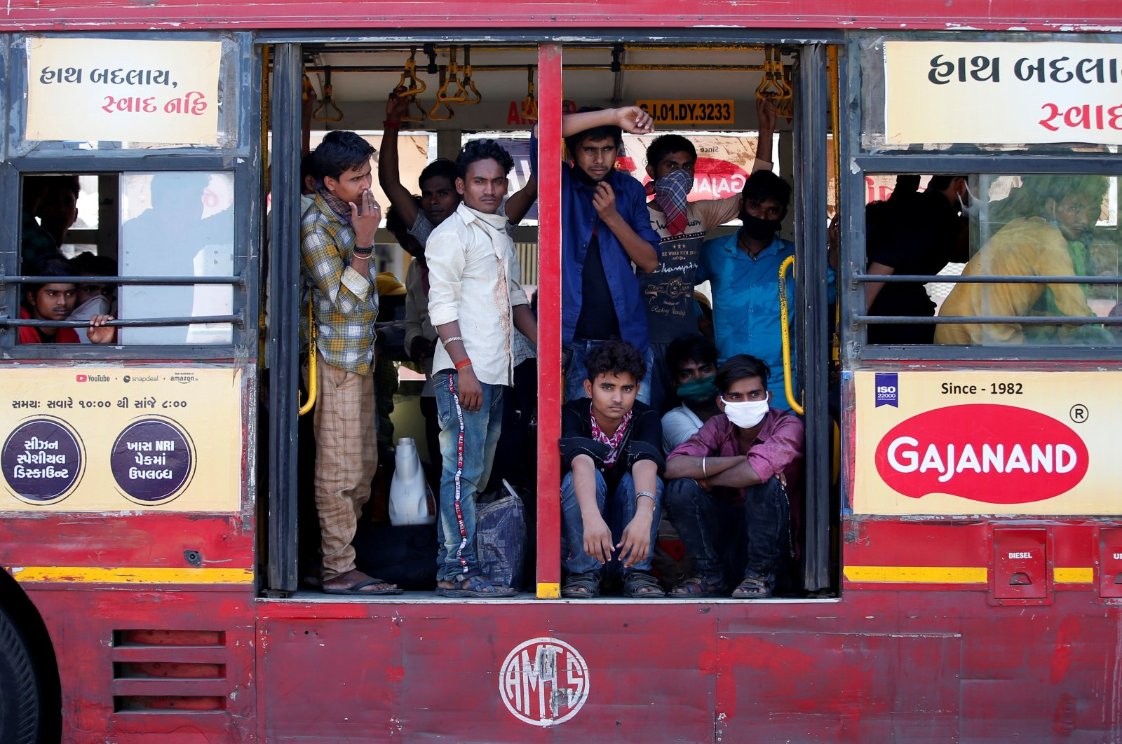 Migrant workers, who were stranded in the western state of Gujarat due to a lockdown imposed by the government to prevent the spread of the coronavirus, are seen inside a parked bus as they wait to board a train that will take them to their home state of eastern Bihar, in Ahmedabad, India, May 8, 2020. (Reuters Photo)