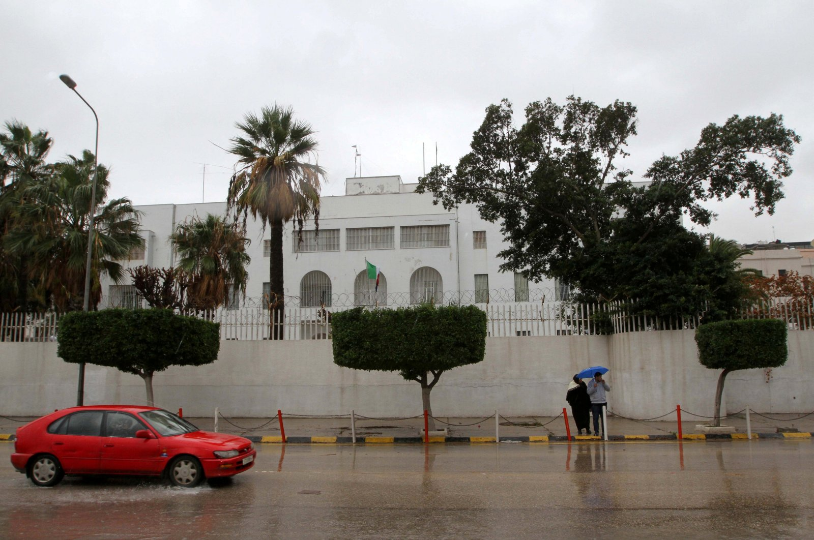 A car drives past the Italian Embassy in Tripoli, Libya, Jan. 10, 2017. (Reuters File Photo)