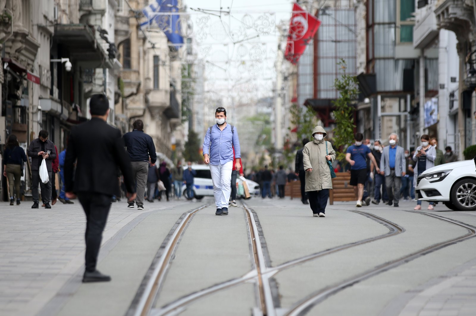 People wearing masks walking at İstiklal Avenue, in Istanbul, Turkey, May 8, 2020. (AA Photo)