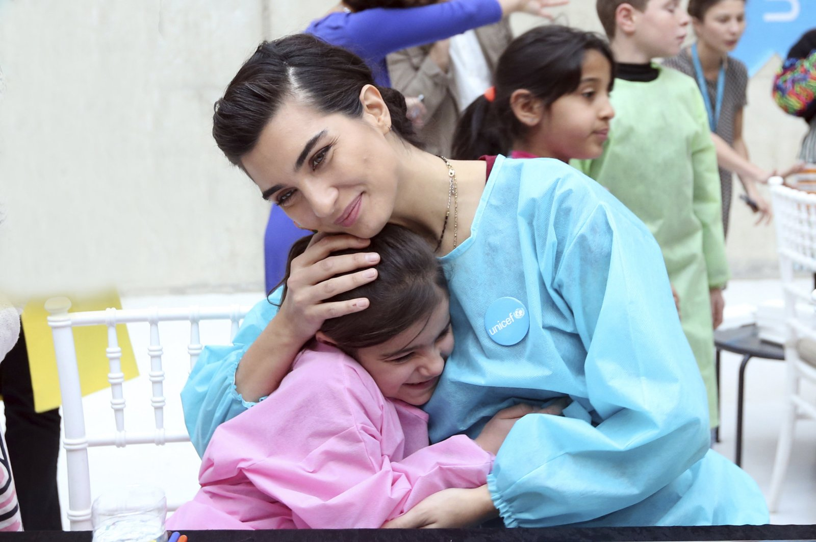 Famous Turkish actress Tuba Büyüküstün, who is also a UNICEF goodwill ambassador, in an organization for refugee children, in Turkey, 2018. (AA Photo)