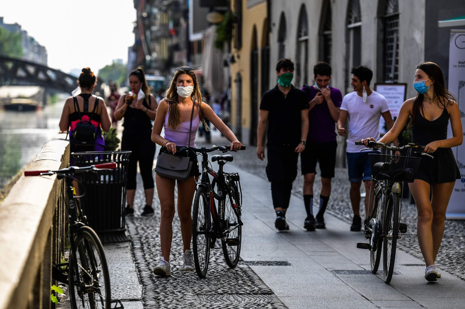 People stroll along the Navigli canals in Milan, Italy, May 8, 2020. (AFP Photo)