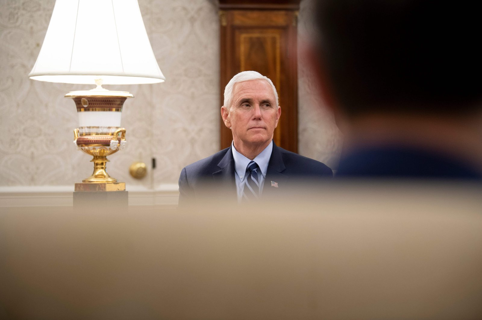 U.S. Vice President Mike Pence listens as Texas's Governor Greg Abbott and U.S. President Donald Trump speak to the press after a meeting in the Oval Office of the White House May 7, 2020, in Washington, DC. (AFP Photo)