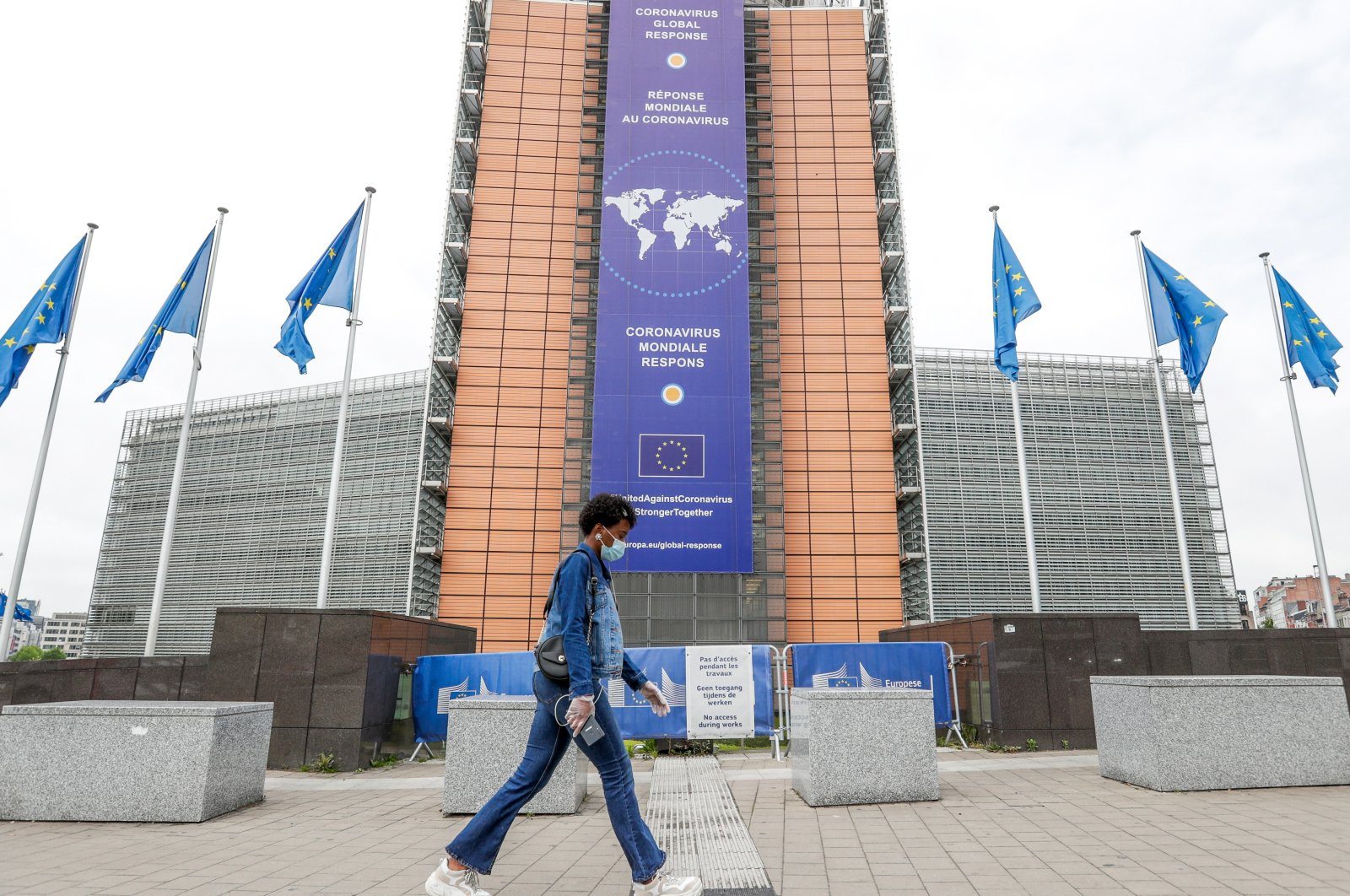 A woman walks in front the European Commission headquarters in Brussels, Belgium, May 4, 2020. (EPA Photo)