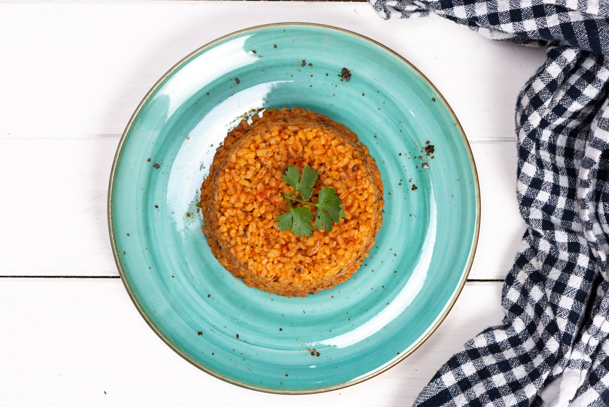 Depending on the amount of tomato paste you use, your bulgur may look more red. (iStock Photo)