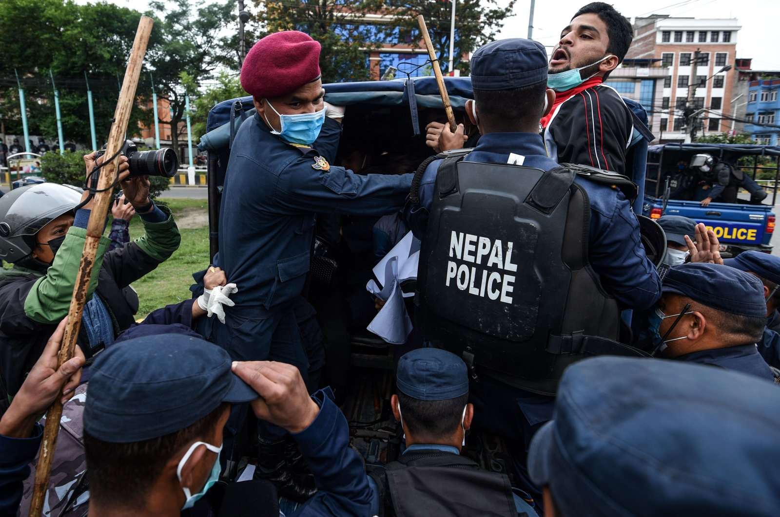 Police detain demonstrators during a protest against India's newly inaugurated link road to the Chinese border, Kathmandu, Nepal, May 10, 2020. (Reuters Photo)
