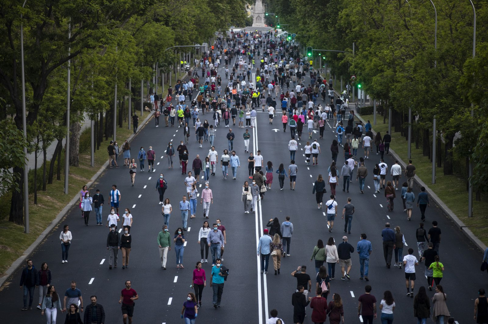 People exercise along Paseo de la Castellana after the lifting of coronavirus lockdown measures imposed by the government, Madrid, May 9, 2020. (AP Photo)