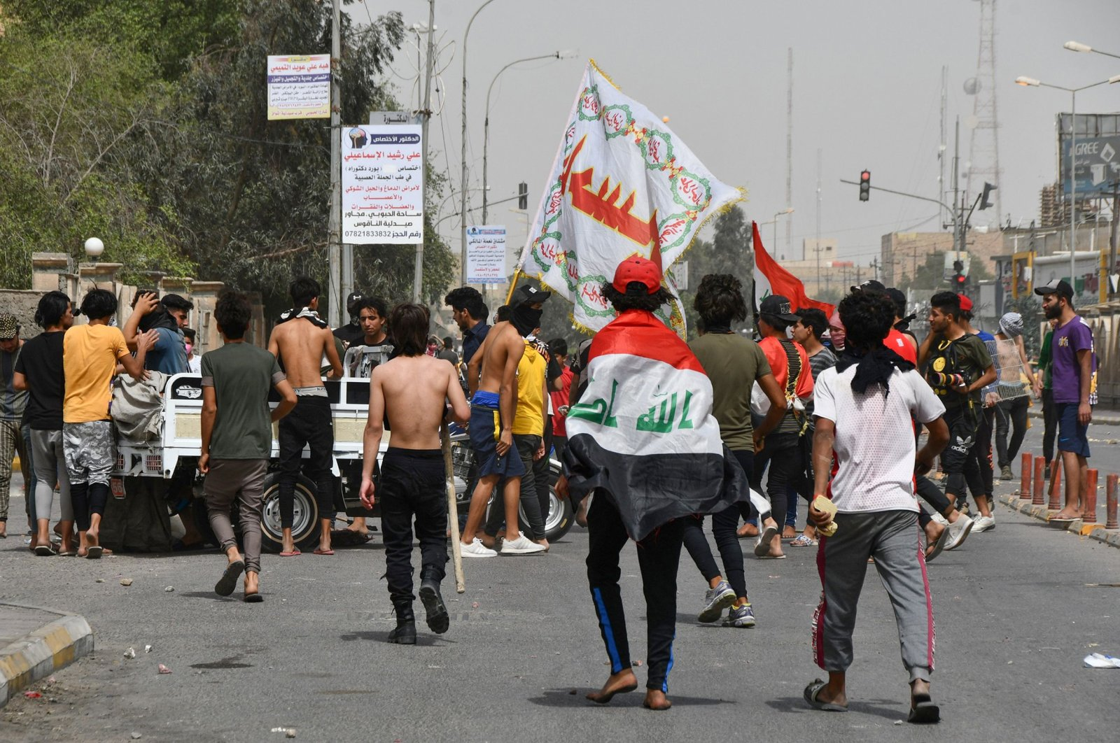 Iraqi protesters gather to block a street during an anti-government demonstration in Iraq's southern city of Nasiriyah, Dhi Qar province, May 10, 2020. (AFP Photo)