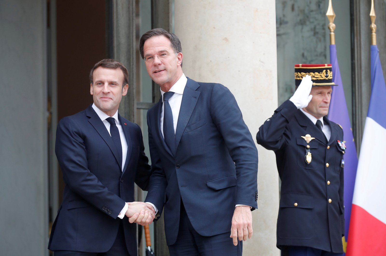 French President Emmanuel Macron welcomes Dutch Prime Minister Mark Rutte for a working lunch at the Elysee Palace in Paris, France, Feb. 14, 2020. (Reuters Photo)