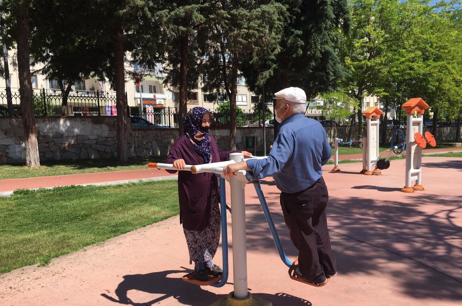An elderly couple exercising at a park in Denizli, Turkey, May 10, 2020. (İHA Photo)