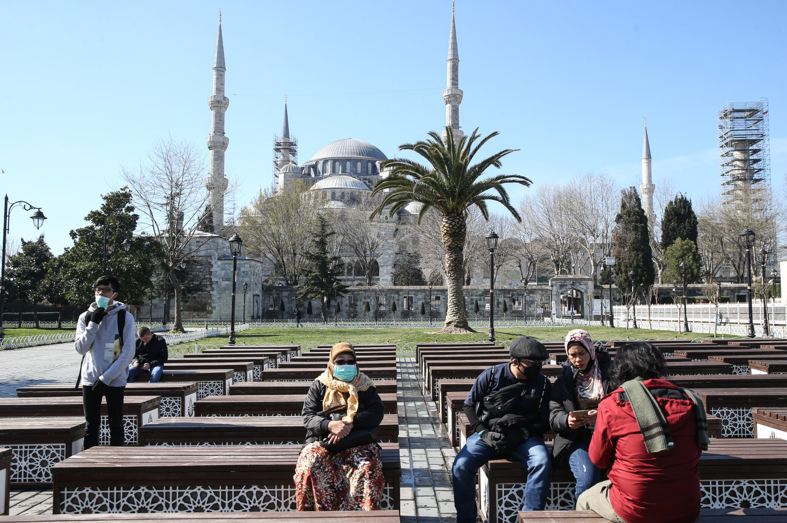 Tourists are seen near Sultanahmet Mosque, also known as the Blue Mosque, during the coronavirus outbreak, Istanbul, Turkey, March 21, 2020. (AA Photo)