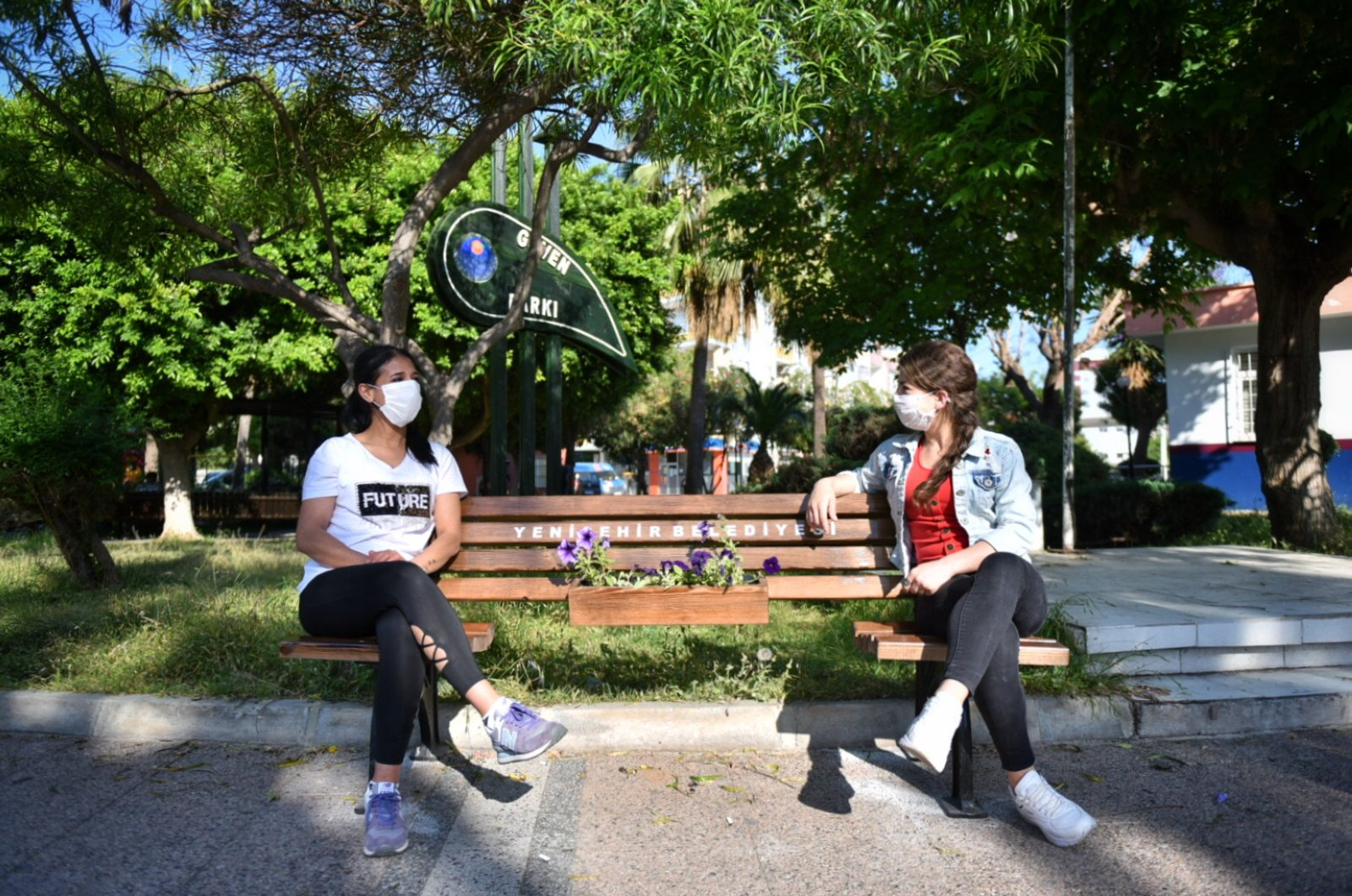 Two women sit on a bench designed to encourage social distancing amid measures to curb the spread of COVID-19, Mersin, Turkey, May 10, 2020. (AA Photo)