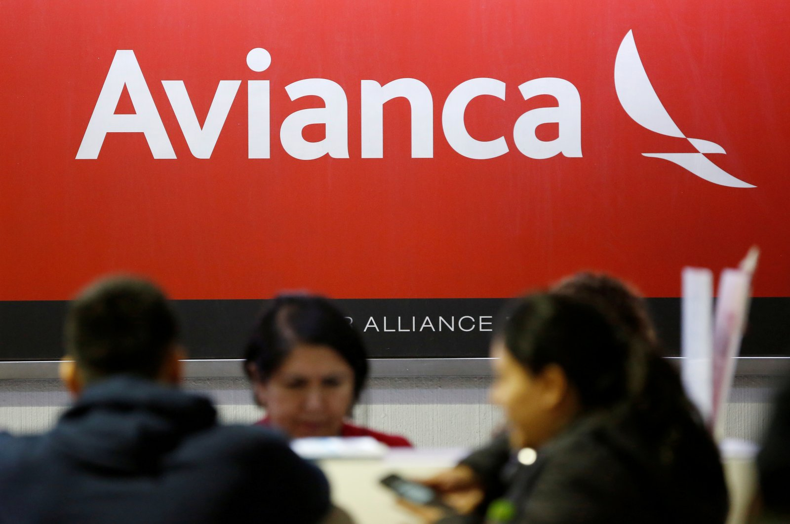 The logo of Avianca Airlines is pictured at a counter following the cancellation of Avianca flight 431, after El Salvador's President Nayib Bukele accused Mexico of allowing a dozen confirmed coronavirus (COVID-19) cases to board the flight due to leave Mexico City for San Salvador, at the Benito Juarez International Airport in Mexico City, Mexico, March 16, 2020.  (Reuters File Photo)