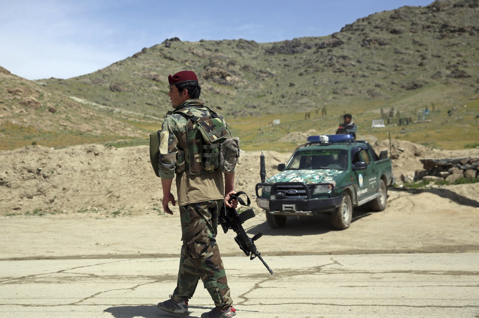 Afghan security personnel stand guard at the site of a suicide bomber attack on the southern outskirts of Kabul, Afghanistan, April 29, 2020. (AP Photo)