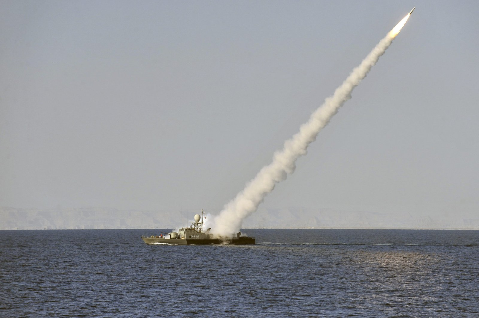 In this image made available by the Iranian Students News Agency, an Iranian Navy vessel launches a missile during a drill in the Sea of Oman, Jan. 1, 2012. (AP File Photo)