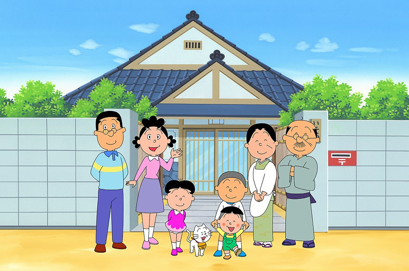 """An image from the """"Sazae-san"""" TV cartoon series, with the character, Sazae-san, (2nd L) and her family in front of their house, from the Hasagawa Michiko Art Museum in Tokyo, May 11, 2020. (AFP)"""