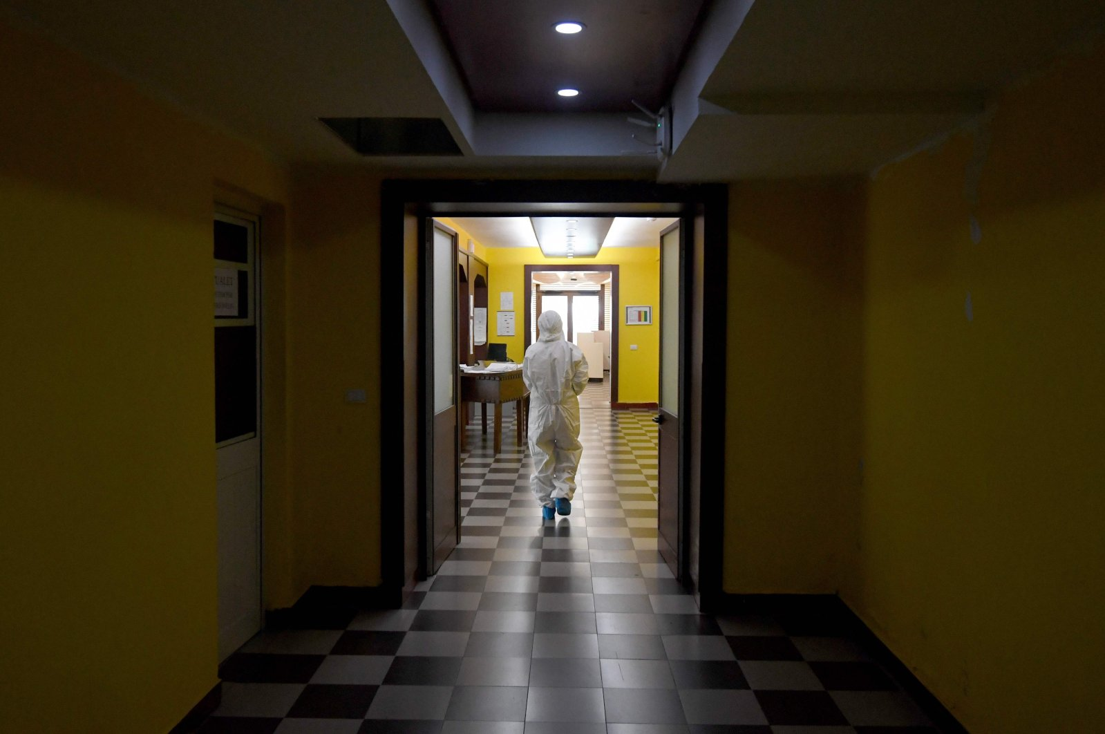 A medical worker walks through a corridor at the Shefqet Ndroqi Sanatorium hospital converted to receive patients infected with COVID-19 in Tirana, Albania, April 30, 2020. (AFP Photo)