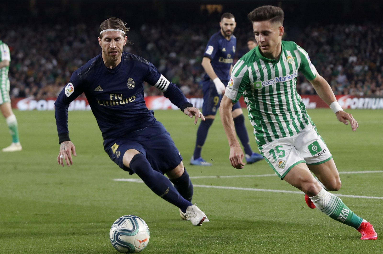 Real Madrid's Sergio Ramos fights for the ball against Betis' Alex Moreno during a La Liga match in Seville, Spain, March. 8, 2020. (AP Photo)