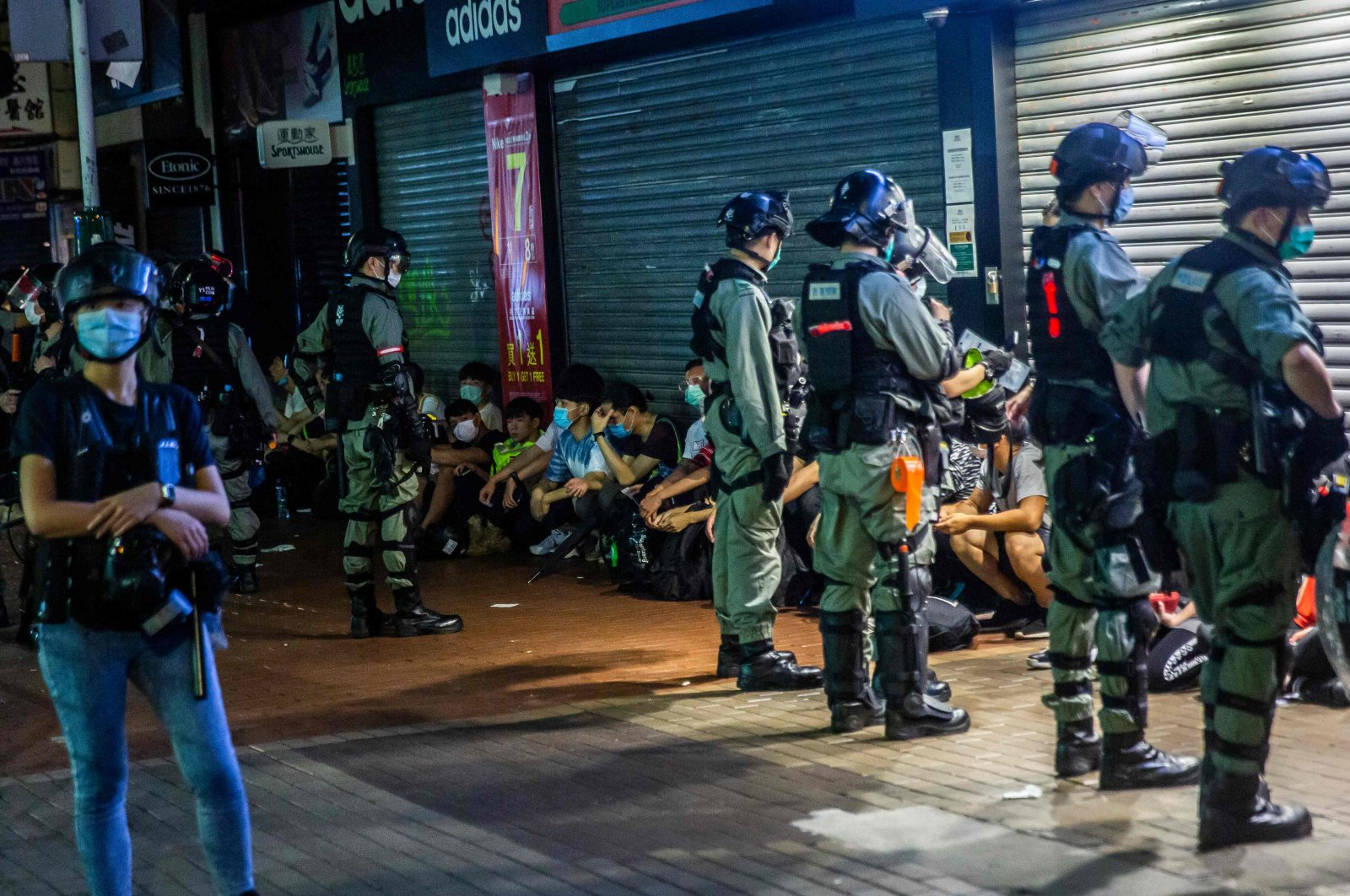 Police detain a group of people during a protest, Hong Kong, May 10, 2020. (AFP Photo)
